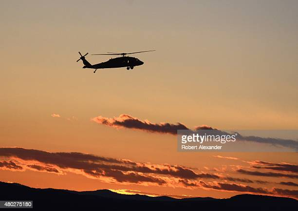 New Mexico National Guard Blackhawk Helicopter takes off at dusk from its base near the Santa Fe Municipal Airport in Santa Fe New Mexico