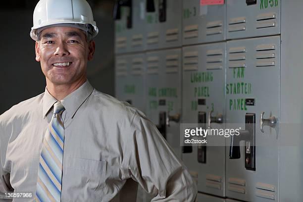 USA, New Mexico, Santa Fe, Portrait of male technician wearing hardhat