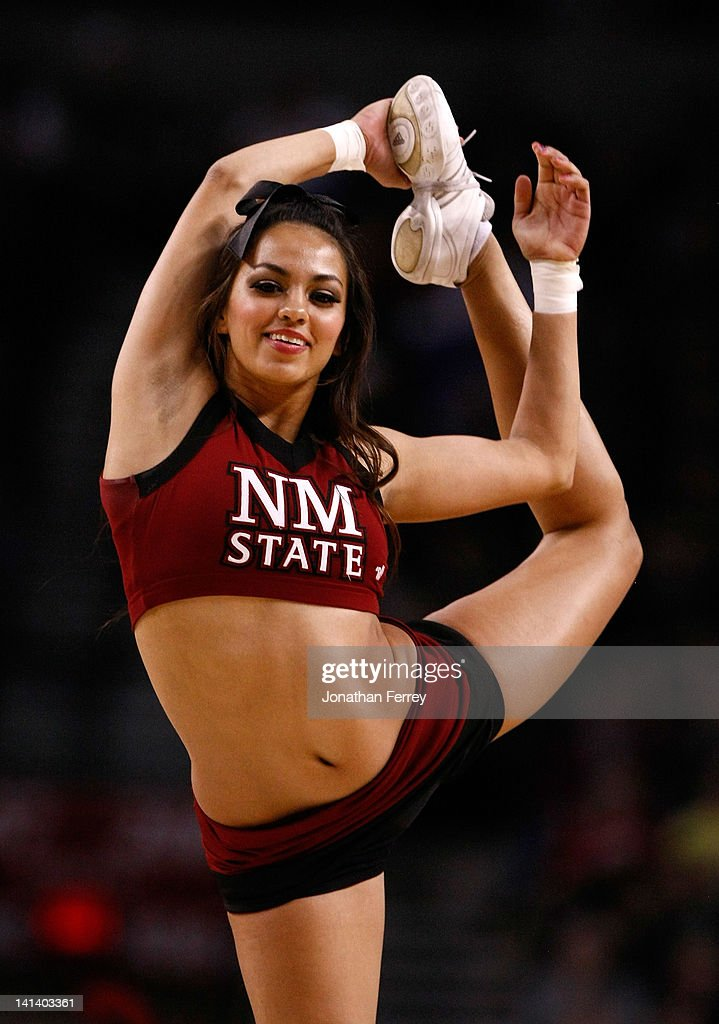 A New Mexico State Aggies cheerleader performs during a break in the game against the Indiana Hoosiers in the second round of the 2012 NCAA men's basketball tournament at Rose Garden Arena on March 15, 2012 in Portland, Oregon.