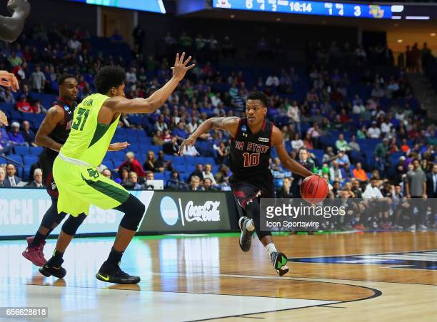 New Mexico State Aggies Forward Jemerrio Jones advances the ball to the paint where Baylor Bears Forward Terry Maston awaits his arrival during the...