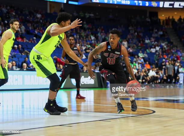 New Mexico State Aggies Forward Jemerrio Jones dribbles to the high post while Baylor Bears Forward Terry Maston defends during the NCAA men's...