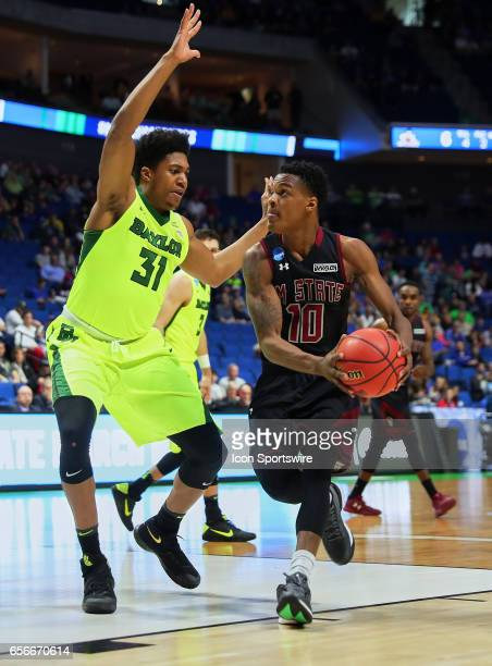 New Mexico State Aggies Forward Jemerrio Jones dribbles to the high post while Baylor Bears Forward Terry Maston defends during the NCAA Division I...
