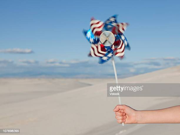 USA, New Mexico, White Sands National Monument, Girl (10-11) holding American pinwheel toy