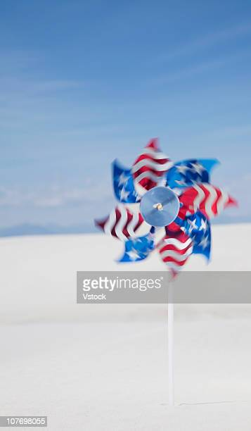 USA, New Mexico, White Sands National Monument, Stars and stripes paper windmill in desert