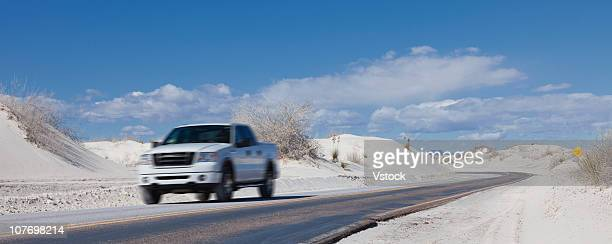 USA, New Mexico, Whitesands, Pick up truck on road