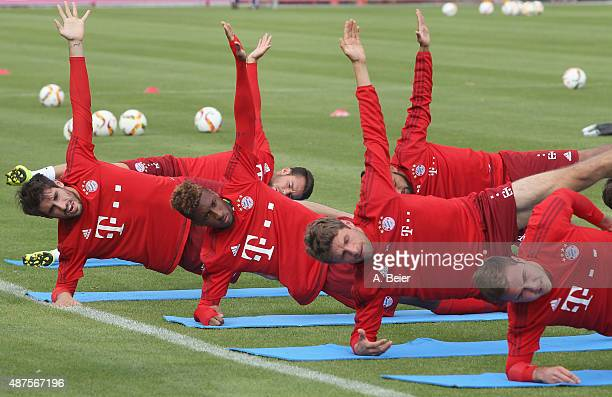 New midfielder Kingsley Coman of FC Bayern Muenchen warms up with teammates during a training session at the FC Bayern Muenchen training ground on...