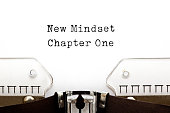 New Mindset Chapter One printed on an old typewriter.
