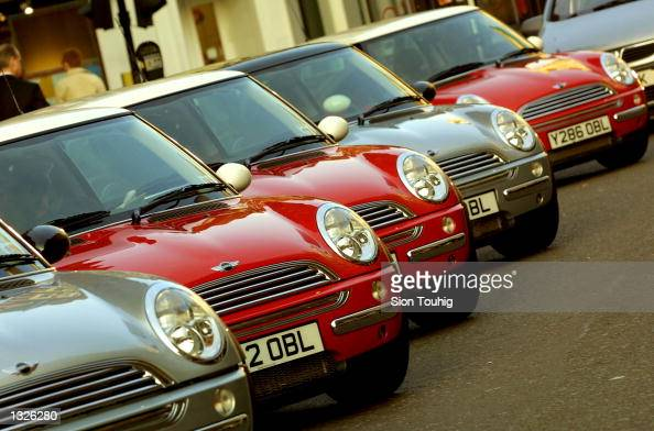 New Mini Cooper cars are parked in a row June 25 2001 in London England as the new car was unveiled to the auto industry press The Mini a 42yearold...
