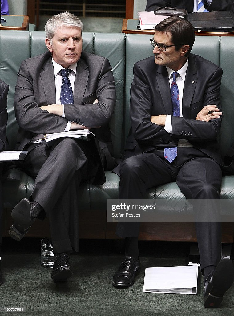 New Minister for Imigration and Citizenship Brendan O'Connor and Greg Combet during House of Representatives question time at Parliament House on February 5, 2013 in Canberra, Australia. Parliament resumes for the first sitting of 2013 today, just days after Prime Minister Gillard, announced a federal election date of September 14, 2013.