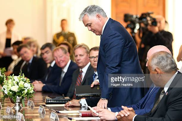 New minister Mark Mitchell is sworn in during a ceremony at Government House on December 20 2016 in Wellington New Zealand Bill English announced his...