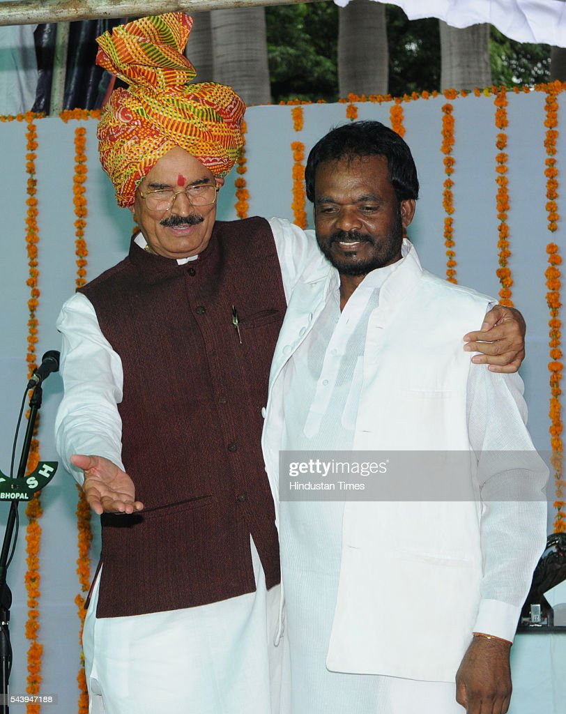 New minister Rustam Singh and Om Prakash Dhurve at Raj Bhavan on June 30, 2016 in Bhopal, India. Madhya Pradesh Chief Minister Shivraj Singh Chouhan expanded his cabinet inducting nine new ministers, four of cabinet rank and five ministers of state.