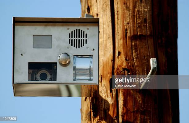 A new motionsensor camera mounted on a power pole keeps watch over potential illegal dumpers and taggers in a alley on August 02 2002 in the south...