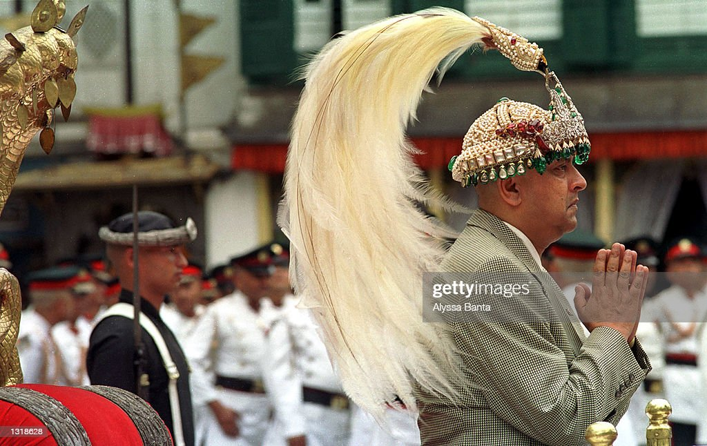 New Nepalese King Gyanendra sits on the throne reserved for coronations and wears the king''s crown during a swearing-in ceremony June 4, 2001 at the Hanuman Palace in Katmandu. Nepal proclaimed its second new king in two days, naming regent Prince Gyanendra as monarch following a mysterious palace massacre which has rocked the Himalayan kingdom to its foundations. Gyanendra is the brother of the late King Birendra. Birendra''s son, Dipendra, was named king on Saturday but died hours later.