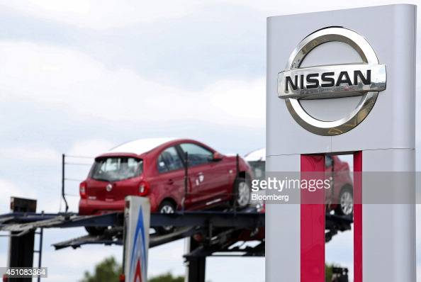New Nissan Micra automobiles produced by Nissan Motor Co sit on the top row of a vehicle transporter ahead of delivery to Toomey Motor Group's car...