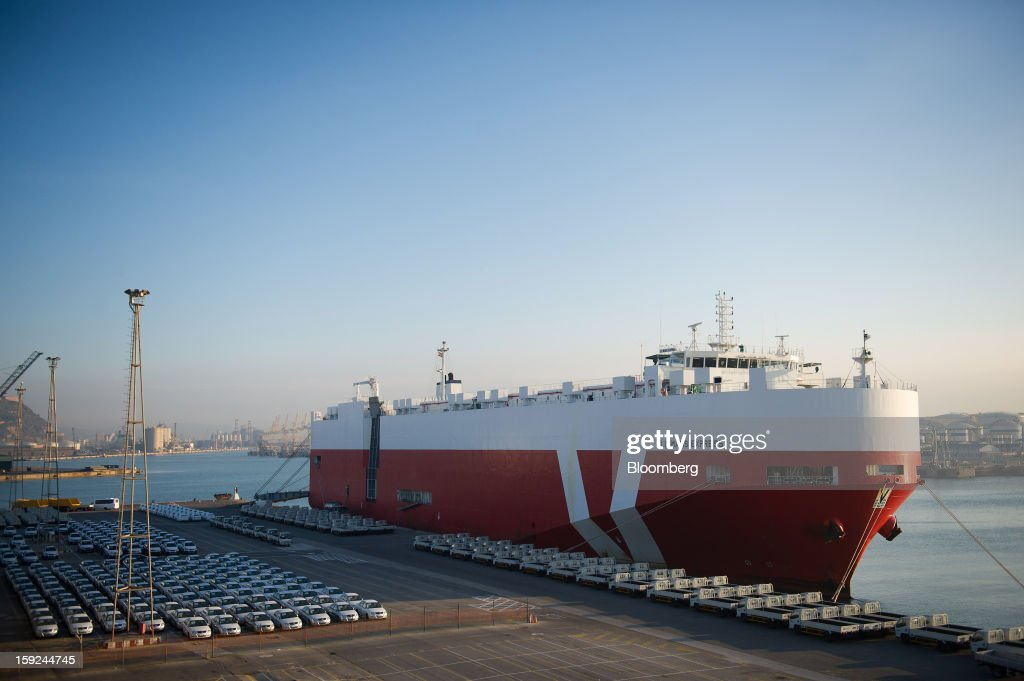 New Nissan Motor Co. and Jiangling Motors Co. automobiles stand on the dockside beside the Le Mans Express roll on, roll off (RoRo) ship at Barcelona port in Barcelona, Spain, on Thursday, Jan. 10, 2013. Spanish exports grew the least in five months in September as the euro area relapsed into a recession and the region's fourth-largest economy continued to contract. Photographer: David Ramos/Bloomberg via Getty Images