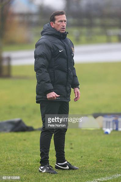 New Northampton Town manager Justin Edinburgh looks on during his first training session at Moulton College on January 16 2017 in Northampton England