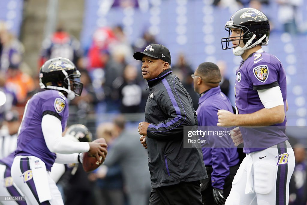 New offensive coordinator Jim Caldwell of the Baltimore Ravens jogs on the field with quarterbacks Tyrod Taylor #2 (L) and Joe Flacco #5 (R) before the start of the Ravens game against the Denver Broncos at M&T Bank Stadium on December 16, 2012 in Baltimore, Maryland.