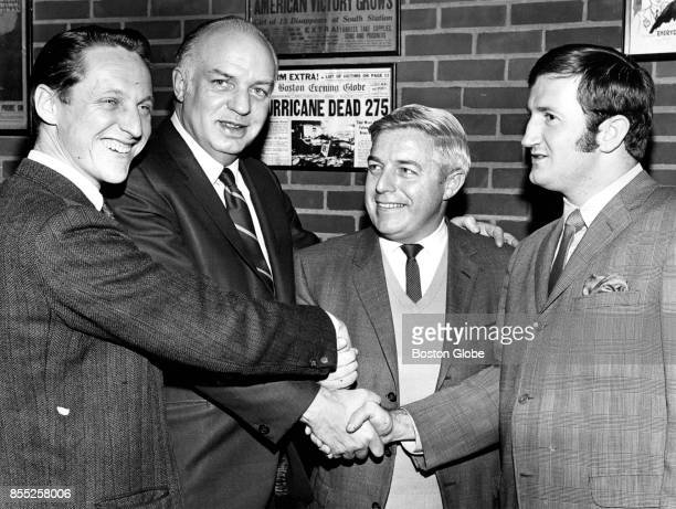 New officers of the Boston Press Club shake hands on Dec 12 1968 From left are Treasurer Dave Ellis of The Boston Globe President Jim Morse of The...
