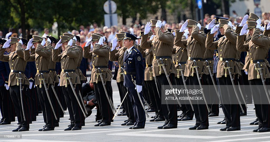 New officers of the Hungarian Army adjust their caps after their military oath the Heroes square of Budapest on August 20, 2013 during the ceremony of the 1013th anniversary of the Hungarian state's establishment.