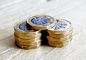 new one pound coin British currency close up