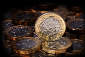 New one pound coin in a spotlight