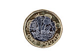 New one pound coin of England UK introduced in 2017 which show emblems of each of the nations cut out and isolated on a white background