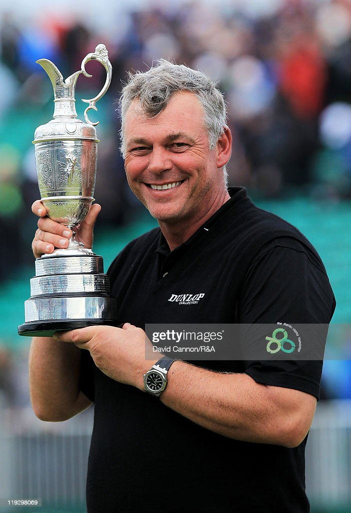 New Open Champion Darren Clarke of Northern Ireland poses with the Claret Jug following his victory during the final round of The 140th Open Championship at Royal St George's on July 17, 2011 in Sandwich, England.