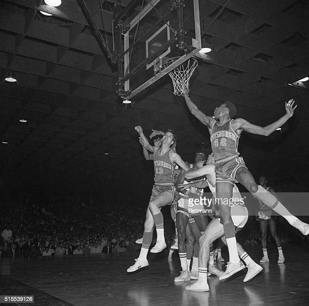Craig Dill and Connie Hawkins of the Pittsburgh Pipers watch a shot by Hawkins go over the basket in the first half of action against New Orleans...