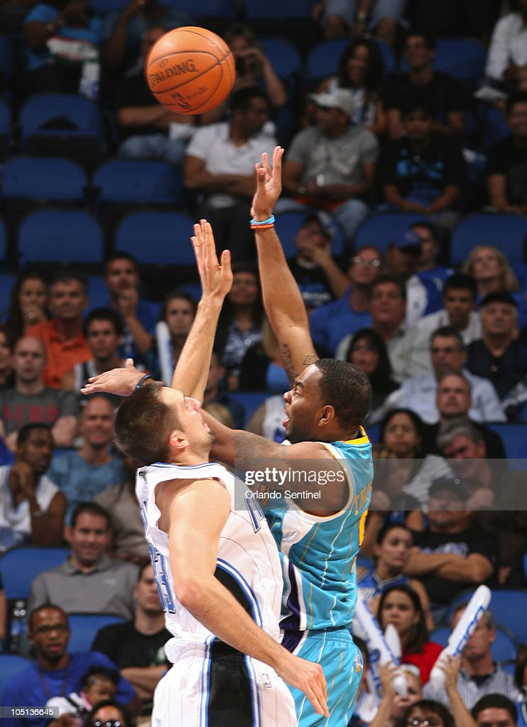 New Orleans guard Marcus Thornton (5) shoots over Orlando Magic forward Ryan Anderson (33) during an NBA preseason game at the new Amway Center on Sunday, October 10, 2010 in Orlando, Florida. The Magic won, 135-81.