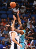 New Orleans guard Marcus Thornton shoots over Orlando Magic forward Ryan Anderson during an NBA preseason game at the new Amway Center on Sunday...