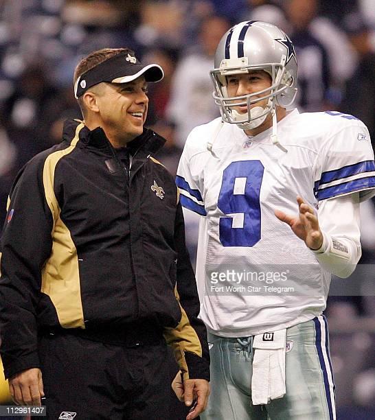 New Orleans head coach Sean Payton talks with Dallas Cowboys quarterback Tony Romo during pregame warm up at Texas Stadium in Irving Texas Sunday...