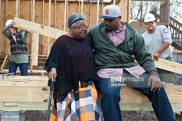 New Orleans home owner Ms Mary Rush whose house is being completely rebuilt after being devastated by Hurricane Katrina sits with NFL New Orleans...