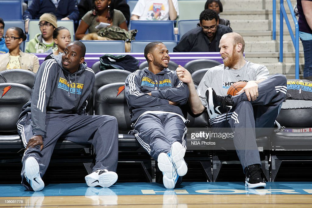 New Orleans Hornets forward <a gi-track='captionPersonalityLinkClicked' href=/galleries/search?phrase=Al-Farouq+Aminu&family=editorial&specificpeople=5042446 ng-click='$event.stopPropagation()'>Al-Farouq Aminu</a>, guard <a gi-track='captionPersonalityLinkClicked' href=/galleries/search?phrase=Eric+Gordon+-+Basketball+Player&family=editorial&specificpeople=4212733 ng-click='$event.stopPropagation()'>Eric Gordon</a> and center <a gi-track='captionPersonalityLinkClicked' href=/galleries/search?phrase=Chris+Kaman&family=editorial&specificpeople=201661 ng-click='$event.stopPropagation()'>Chris Kaman</a> (L-R) share a laugh on the sidelines during an open scrimmage on December 17, 2011 at the New Orleans Arena in New Orleans, Louisiana.