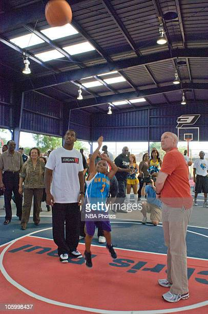 New Orleans Hornets guard and Olympic gold medalist Chris Paul watches a youth take a shot where he teamed up with New Orleans Mayor Mitch Landrieu...