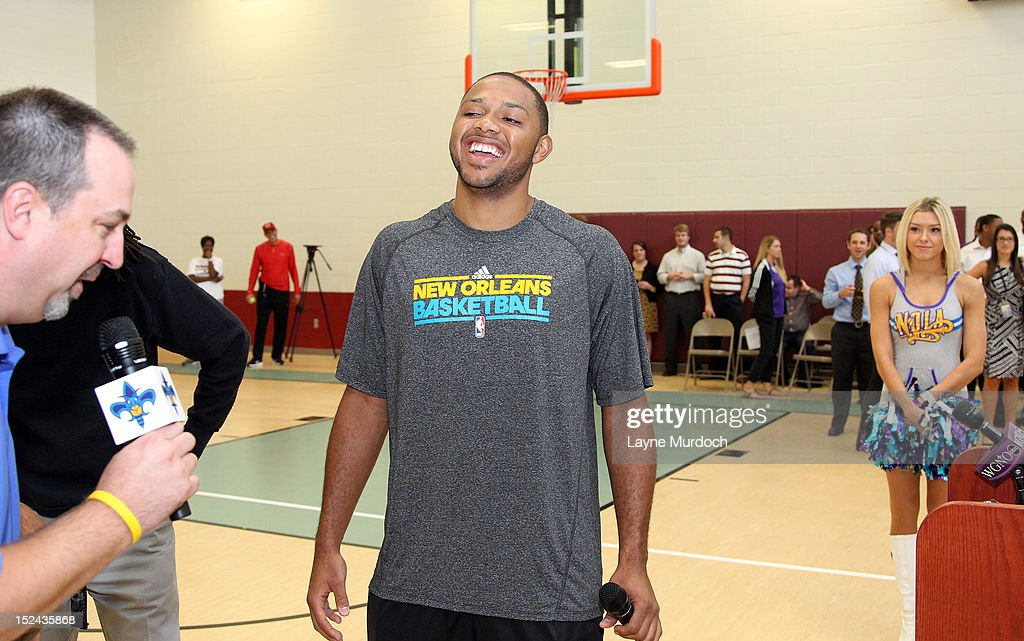 New Orleans Hornets guard <a gi-track='captionPersonalityLinkClicked' href=/galleries/search?phrase=Eric+Gordon+-+Basketball+Player&family=editorial&specificpeople=4212733 ng-click='$event.stopPropagation()'>Eric Gordon</a> smiles as he visits Langston Hughes Academy Charter School on September 20, 2012 at the Langston Hughes Academy Charter School in New Orleans, Louisiana.