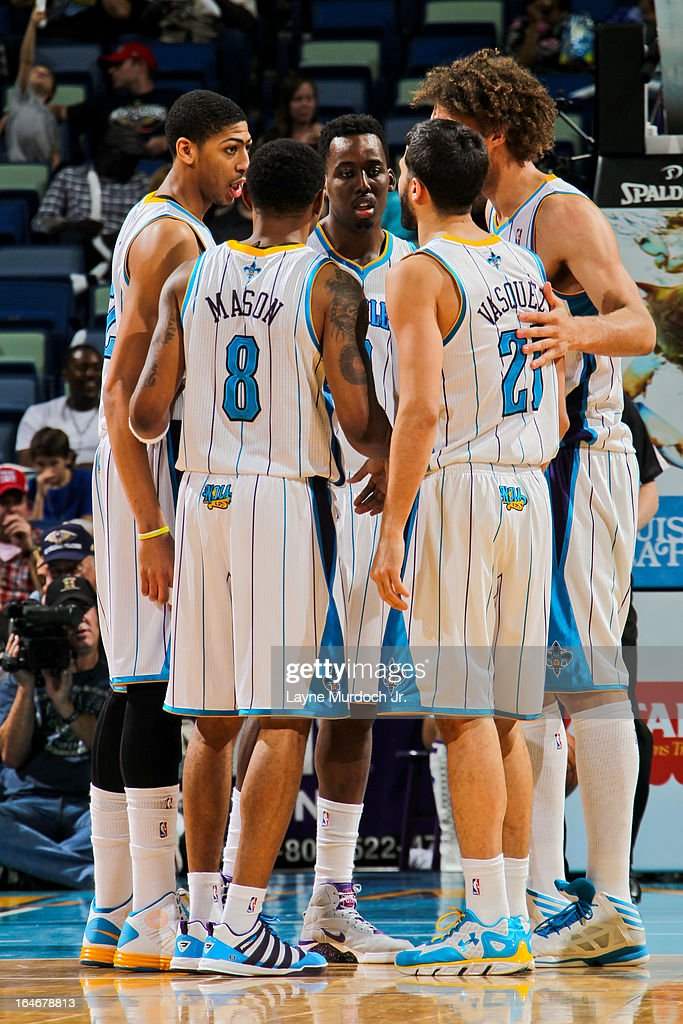 New Orleans Hornets players, from left, Anthony Davis #23, Roger Mason Jr. #8 and Al-Farouq Aminu #0, Greivis Vasquez #21 and Robin Lopez #15 huddle up during a game against the Golden State Warriors on March 18, 2013 at the New Orleans Arena in New Orleans, Louisiana.