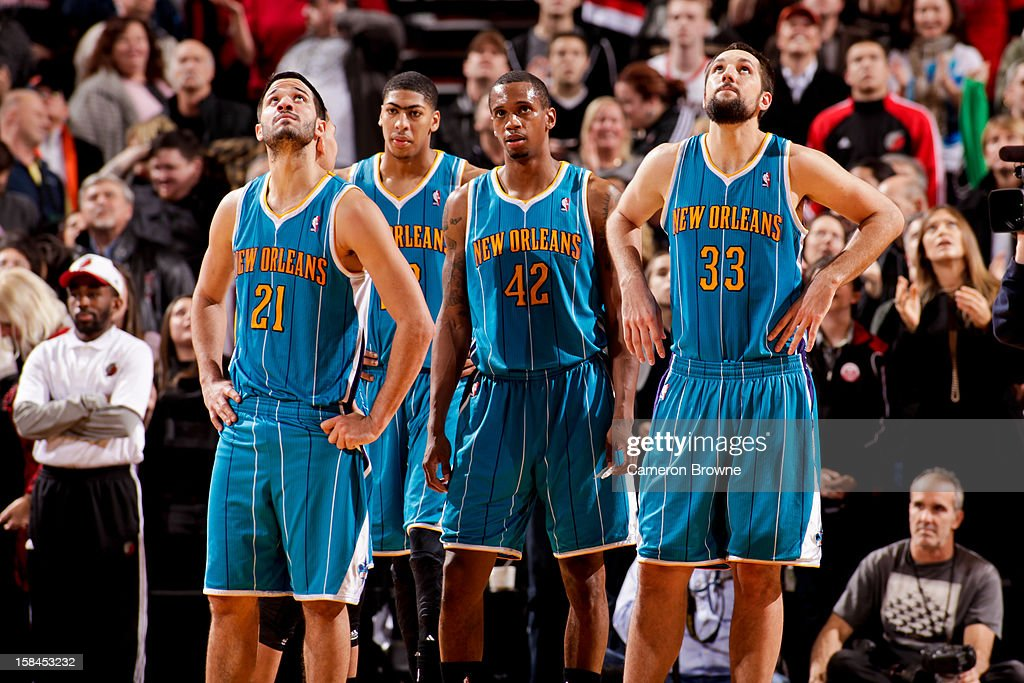 New Orleans Hornets players, from left, Greivis Vasquez #21, Anthony Davis #23, Lance Thomas #42 and Ryan Anderson #33 wait to resume action after losing the lead to the Portland Trail Blazers with less than a second to play on December 16, 2012 at the Rose Garden Arena in Portland, Oregon.