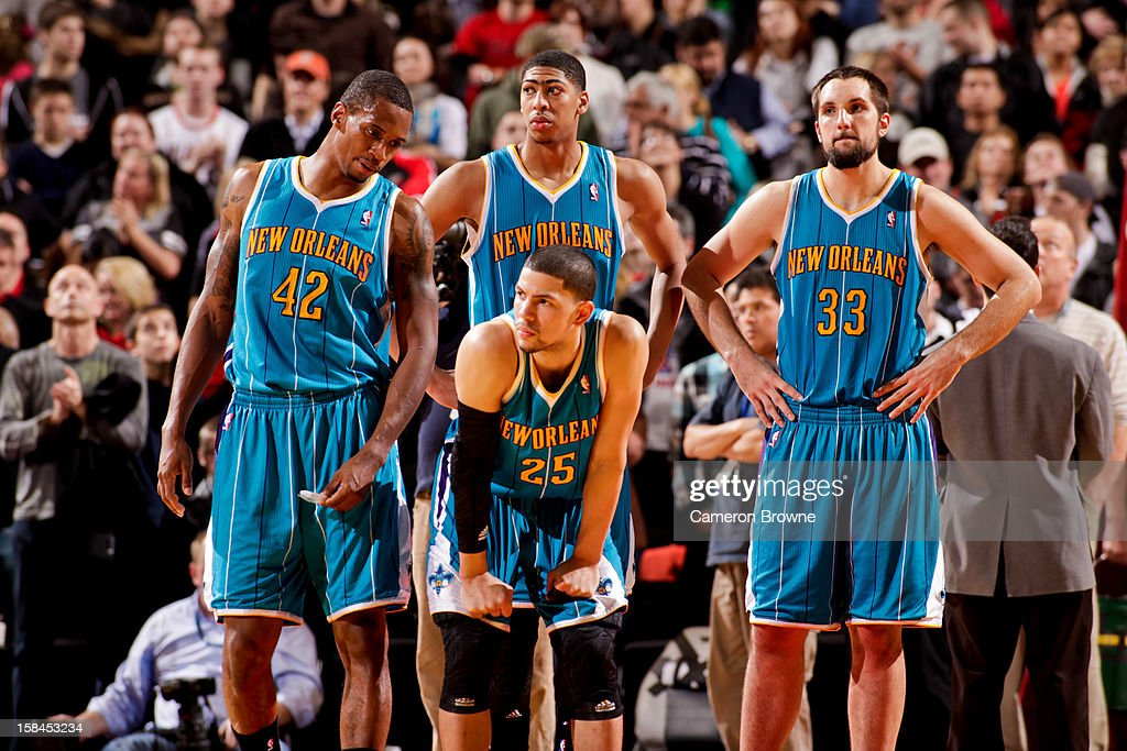 New Orleans Hornets players, from left, <a gi-track='captionPersonalityLinkClicked' href=/galleries/search?phrase=Lance+Thomas&family=editorial&specificpeople=3847256 ng-click='$event.stopPropagation()'>Lance Thomas</a> #42, Anthony Davis #23, <a gi-track='captionPersonalityLinkClicked' href=/galleries/search?phrase=Austin+Rivers&family=editorial&specificpeople=7117574 ng-click='$event.stopPropagation()'>Austin Rivers</a> #25 and Ryan Anderson #33 wait to resume action after losing the lead to the Portland Trail Blazers with less than a second to play on December 16, 2012 at the Rose Garden Arena in Portland, Oregon.