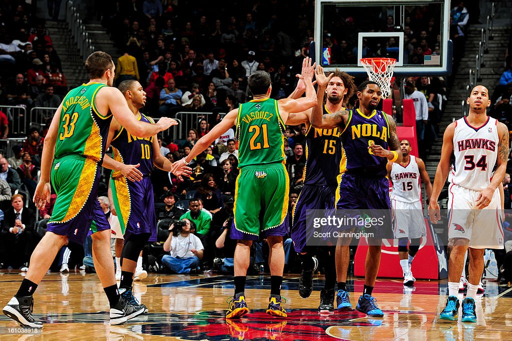 New Orleans Hornets players, from left, Ryan Anderson #33, <a gi-track='captionPersonalityLinkClicked' href=/galleries/search?phrase=Eric+Gordon+-+Basketball+Player&family=editorial&specificpeople=4212733 ng-click='$event.stopPropagation()'>Eric Gordon</a> #10, <a gi-track='captionPersonalityLinkClicked' href=/galleries/search?phrase=Greivis+Vasquez&family=editorial&specificpeople=4066977 ng-click='$event.stopPropagation()'>Greivis Vasquez</a> #21, <a gi-track='captionPersonalityLinkClicked' href=/galleries/search?phrase=Robin+Lopez&family=editorial&specificpeople=2351509 ng-click='$event.stopPropagation()'>Robin Lopez</a> #15 and <a gi-track='captionPersonalityLinkClicked' href=/galleries/search?phrase=Roger+Mason+Jr.&family=editorial&specificpeople=220399 ng-click='$event.stopPropagation()'>Roger Mason Jr.</a> #8 celebrate while playing the Atlanta Hawks on February 8, 2013 at Philips Arena in Atlanta, Georgia.