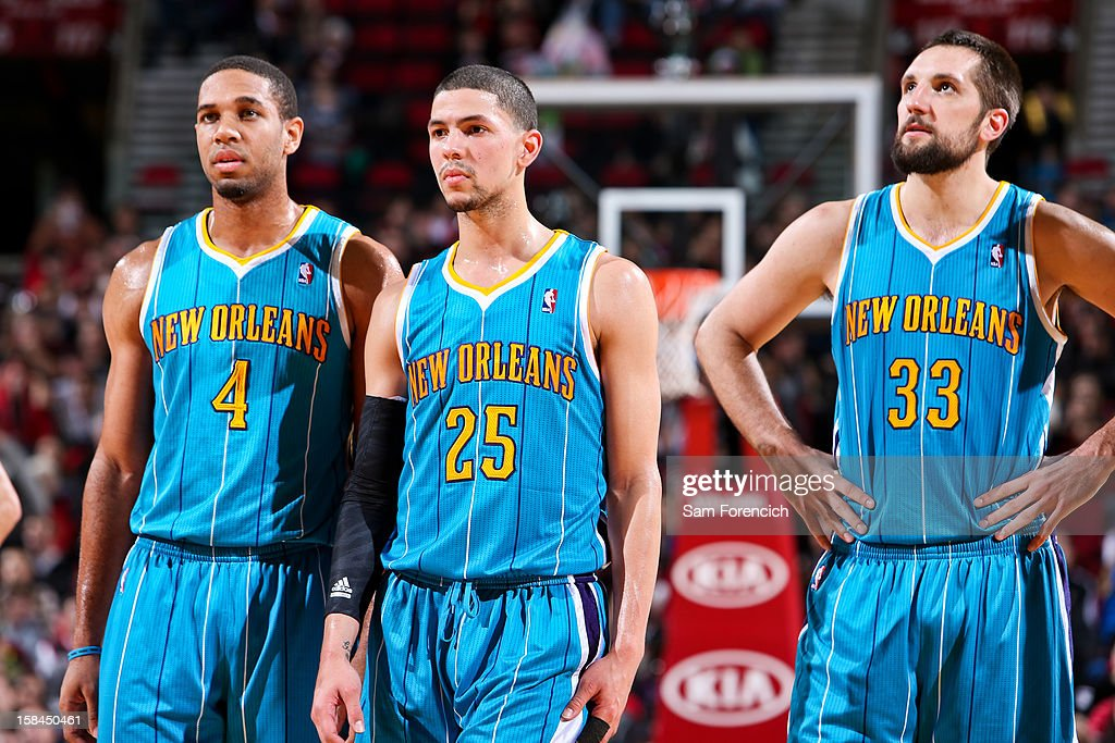 New Orleans Hornets players Xavier Henry #4, Austin Rivers #25 and Ryan Anderson #33 wait to resume action against the Portland Trail Blazers on December 16, 2012 at the Rose Garden Arena in Portland, Oregon.