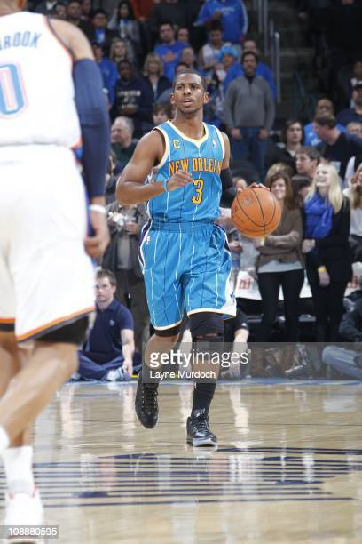 New Orleans Hornets point guard Chris Paul brings the ball up court during the game against the Oklahoma City Thunder on February 2 2011 at the Ford...