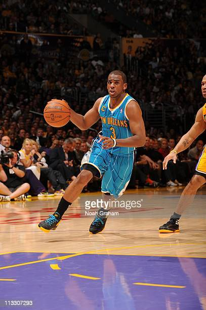 New Orleans Hornets point guard Chris Paul brings the ball up court during the game against the Los Angeles Lakers in Game Five of the Western...