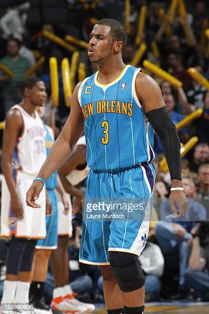 New Orleans Hornets point guard Chris Paul looks on during the game against the Oklahoma City Thunder on February 2 2011 at the Ford Center in...