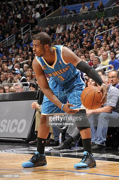 New Orleans Hornets point guard Chris Paul protects the ball during the game against the Orlando Magic on February 11 2011 at the Amway Center in...