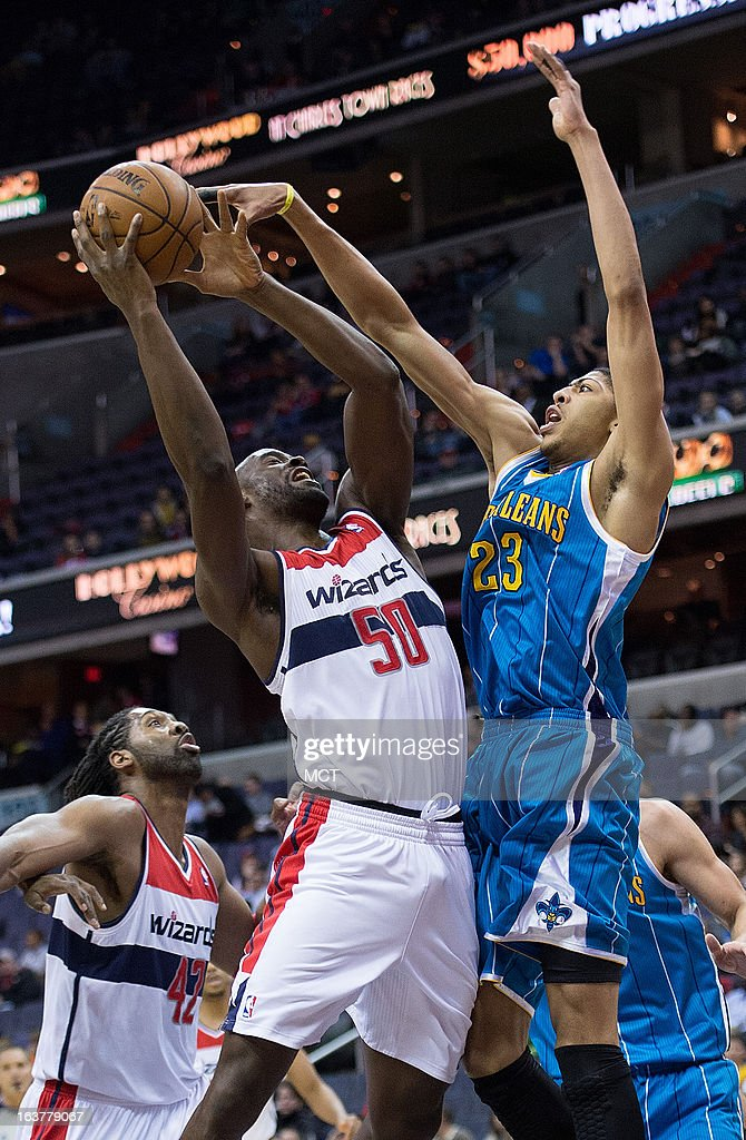 New Orleans Hornets power forward Anthony Davis tries to block a shot by Washington Wizards center Emeka Okafor during the first half of their game...