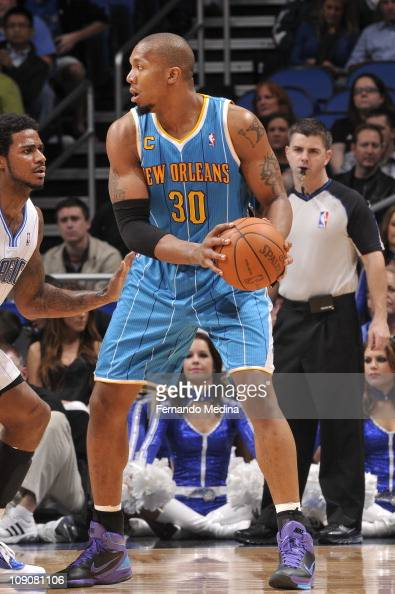 New Orleans Hornets power forward David West protects the ball during the game against the Orlando Magic on February 11 2011 at the Amway Center in...