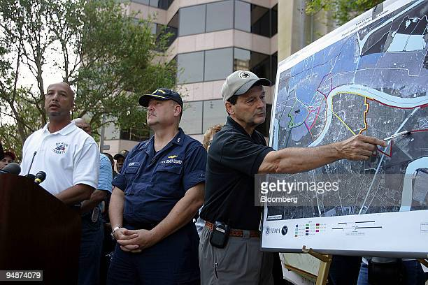 New Orleans Mayor C Ray Nagin left talks about the proposed timeline for returning citizens to the dry areas of the city during a news conference...