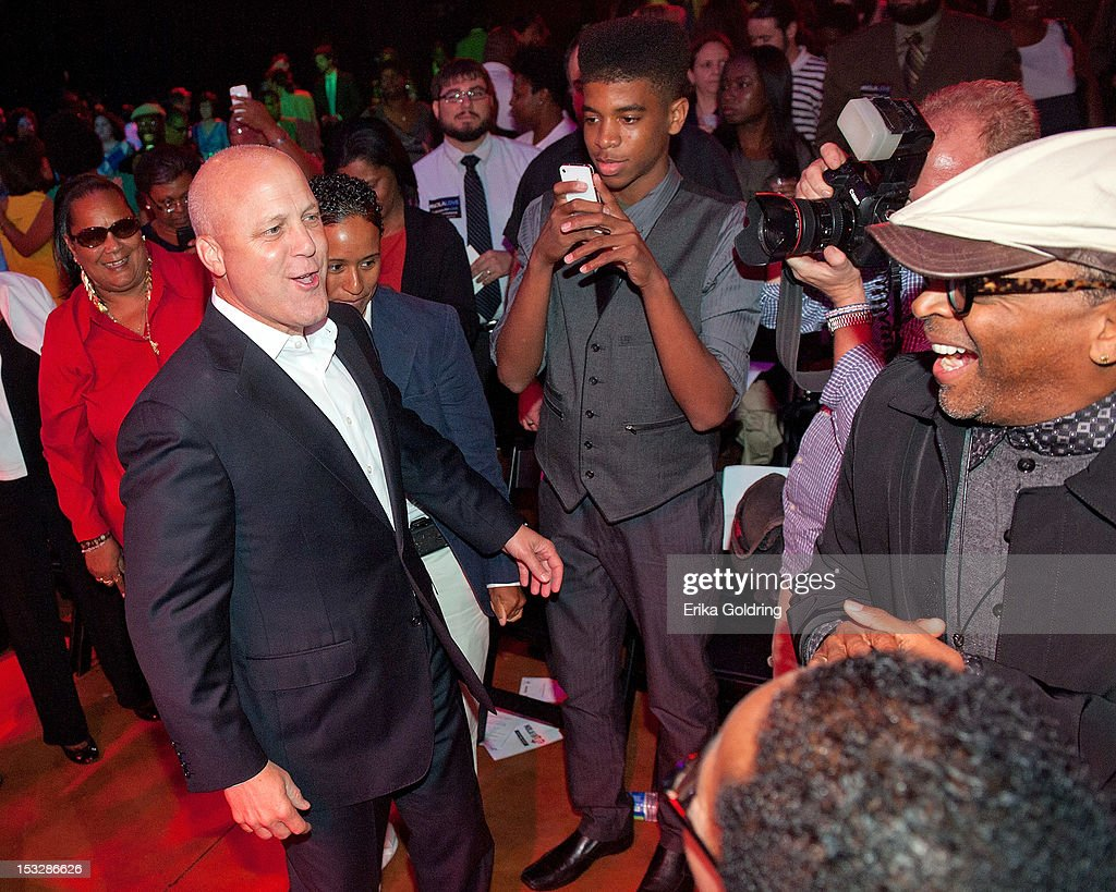 New Orleans Mayor Mitch Landrieu and Director Spike Lee dance to the music of Hot 8 Brass Band at the 'Flip the Script' Public Awareness campaign launch at The Joy Theater on October 2, 2012 in New Orleans, Louisiana.