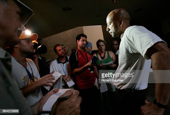 New Orleans Mayor Ray Nagin talks with reporters outside his makeshift office on the fourth floor of the Hyatt Hotel hours after meeting with...