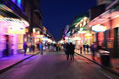 'Moving sense on Bourbon Street, a feeling of the nightlife in New Orleans famous French Quarter.'
